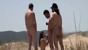 Young brunette wishes for voyeur orgy at the beach