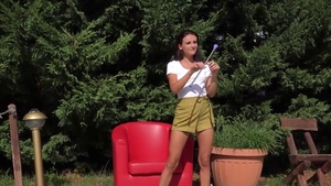 Shaved Gina Gerson teasing outdoors