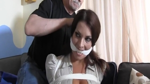 Submissive tied up starring busty brunette