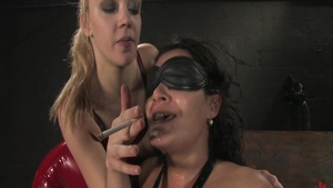 Annette Schwarz escorted by Charley Chase smoking
