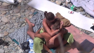 Huge boobs brunette voyeur masturbation at the beach