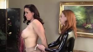 Big booty brunette wearing latex bondage