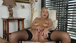 Female masturbating large boobs in tight stockings solo